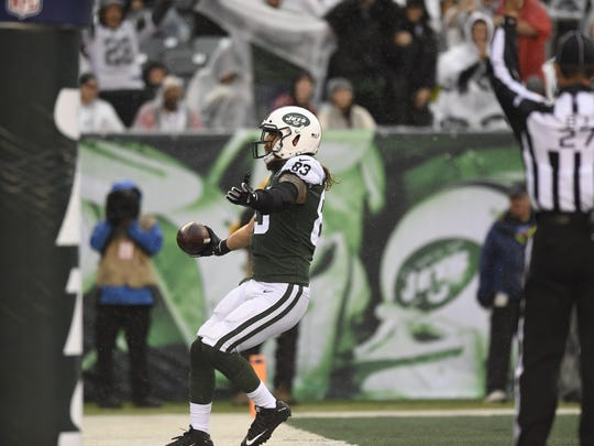 New York Jets tight end Eric Tomlinson (83) celebrates his 20-yard touchdown in the first quarter. The New York Jets lead the Atlanta Falcons 17-13 at the half on Sunday, October 29, 2017 in East Rutherford, NJ.