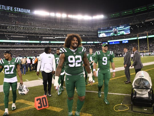 New York Jets defensive end Leonard Williams (92) and teammates walk off the field after defeating the Buffalo Bills 34-21 on Thursday, November 2, 2017 in East Rutherford, NJ.