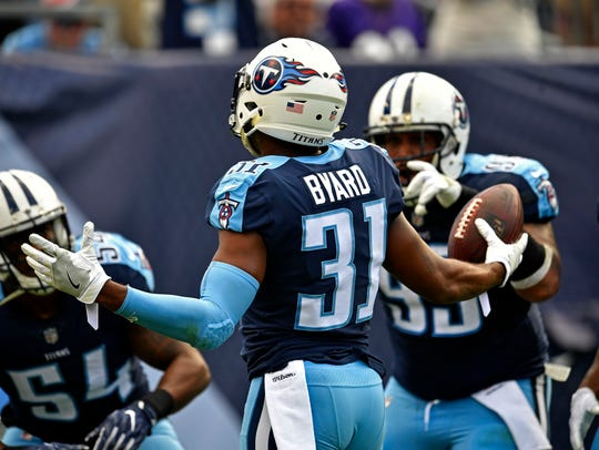 Titans safety Kevin Byard (31) celebrates an interception during the first half Sunday.