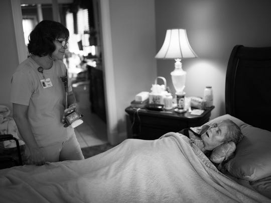 Sharon Brinksneader, a hospice aide with Deaconess VNA, prepares to leave Patty to rest after giving her a bath and making sure she was comfortable.