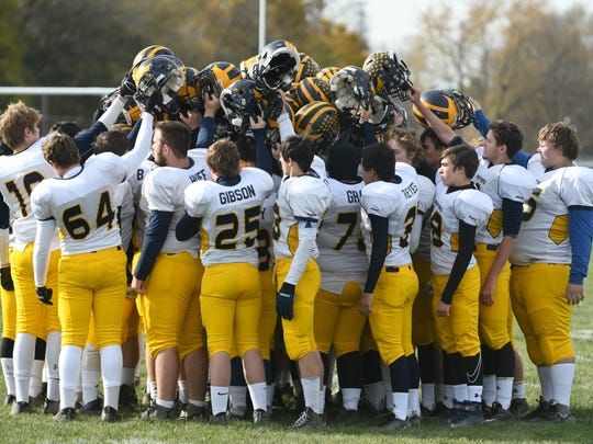 Climax-Scotts teammates gather as a team before Saturday's playoff against rival Mendon.
