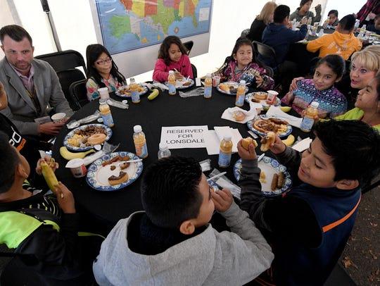Gridsmart employees talk to Lonsdale Elementary School
