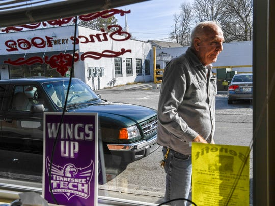 Jimmy Whittaker walks into Ralph's Donut Shop in Cookeville, Tenn., on Nov. 15, 2017.
