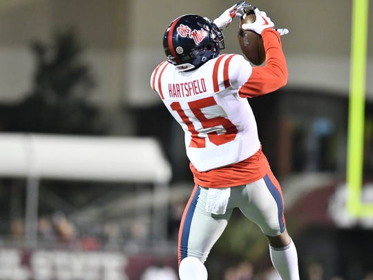 Ole Miss defensive back Myles Hartsfield (15) intercepts a pass against Mississippi State last year.