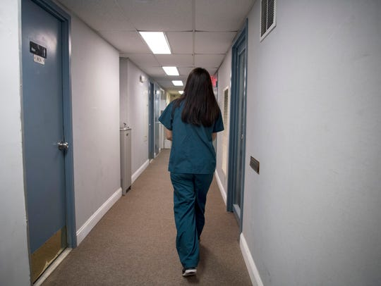 Grace returns to the clinic after walking a patient