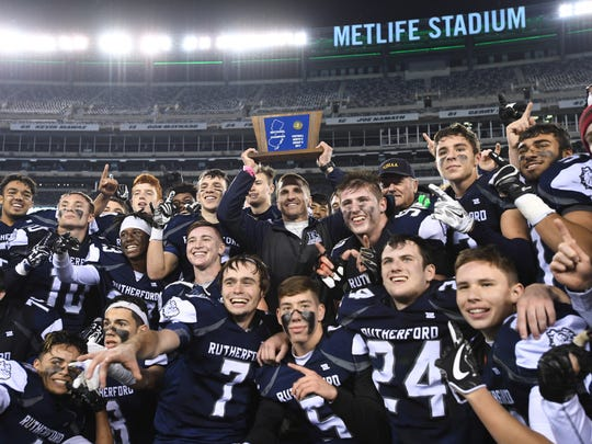 Rutherford celebrates defeating Hackettstown for the North 2, Group 2 championship at MetLife Stadium in East Rutherford on Thursday, Nov. 30, 2017.