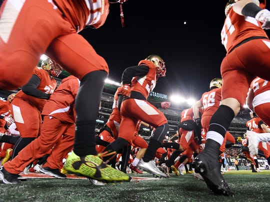Non-Public Group 4 state football final at MetLife Stadium in East Rutherford, on Friday, December 01, 2017.  Bergen Catholic takes the field at the start of the game.