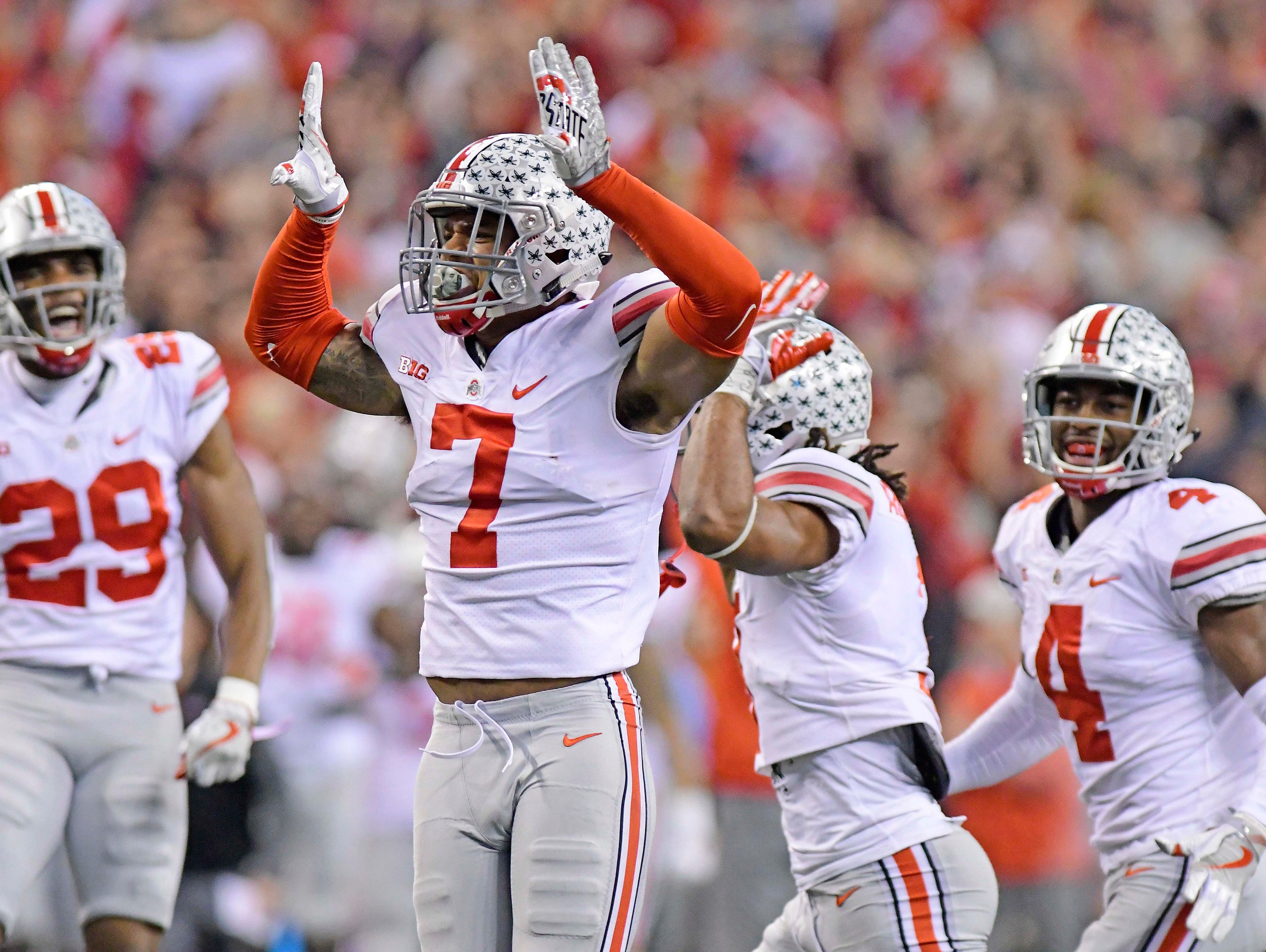 Ohio State safety Damon Webb celebrates after making
