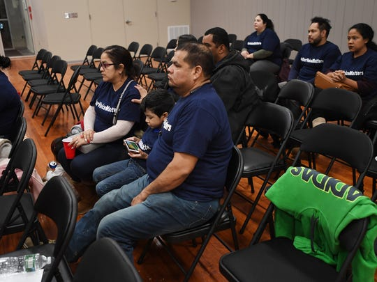 (center) Bertin Palacios, who has children attending Paterson charter schools, sits with his family during a rally in support of charter schools on Wednesday, December 20, 2017, at 52 Front St.