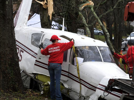 An aircraft recovery team from Clarksville and FAA investigators were on the scene Wednesday, Dec. 20, 2017 where a small plane which crashed yesterday on Groner Dr in East Knoxville. The plane will be cut apart and removed today.