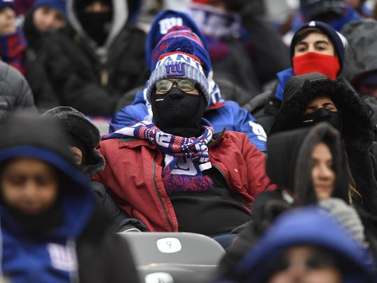 New York Giants fans brave the cold temperatures during