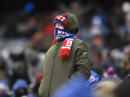 A New York Giants fan braves the cold as the Giants