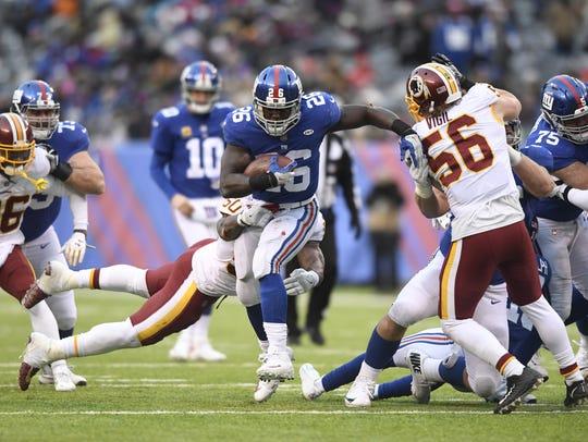 New York Giants running back Orleans Darkwa (26) rushing