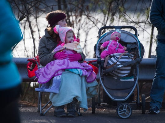 Ashleigh Waddell and her daughter  Caroline, 2, watch