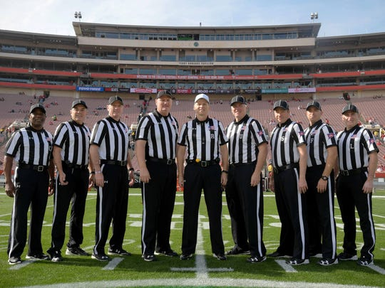 Referees pose for a picture on the 50 yard line before a game between the Oklahoma Sooners and the Georgia Bulldogs in the 2018 Rose Bowl college football playoff semifinal game at Rose Bowl Stadium. Waynesboro's Jim Hyson, the umpire, is the fourth from the right.