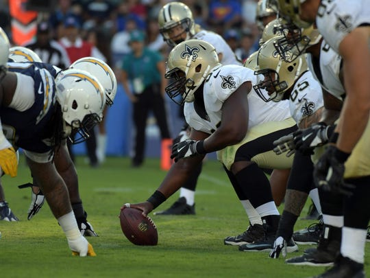 New Orleans Saints center Cameron Tom (63) prepares to snap the ball against the Los Angeles Chargers. Tom played at USM.