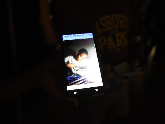 Perla Mondriguez of West Orange shows a picture of