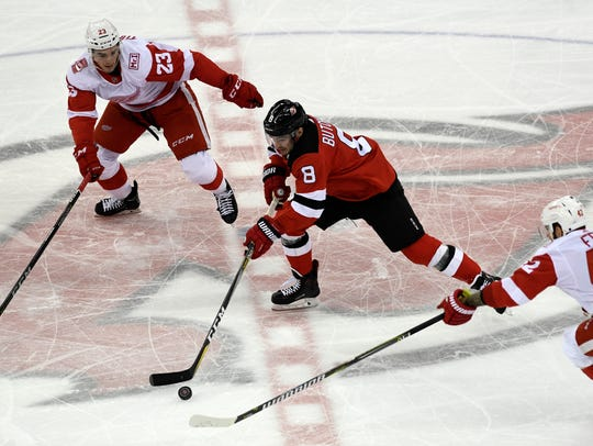 New Jersey Devils defenseman Will Butcher (8) playing