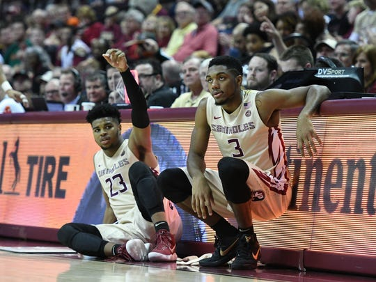 FSU freshman guard MJ Walker (23) and sophmore guard Trent Forrest (3) waiting to be subbed into the game during the second half.
