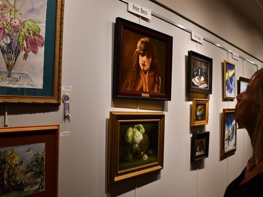 Ninetta Nappi, of North Bergen, looks at her artwork.