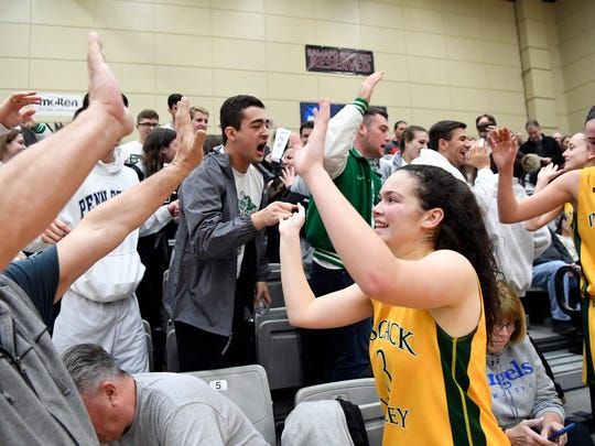Pascack Valley's Kelly Smith celebrates with fans after their win. Pascack Valley defeated Immaculate Conception 53-25 in the Bergen County girls basketball semi finals in Mahwah, NJ on Sunday, February 11, 2018.