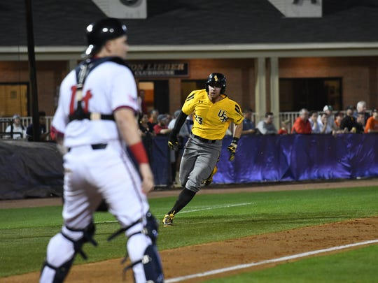 Southern Miss third baseman Luke Reynolds runs toward home plate during Tuesday's game at South Alabama.
