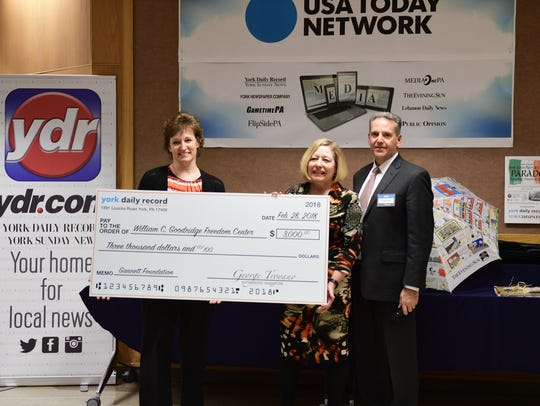 Carol Kauffman and Donna Chandler of the Goodridge Freedom Center accept a check for $3,000 from George Troyano, York Newspaper Co. president. The funds were donated by the Gannett Foundation.