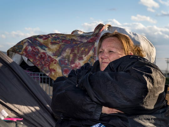 Julie Bradshaw, 46 and homeless for most of her life, talks about her living conditions in Tulare on Thursday, February 22, 2018.