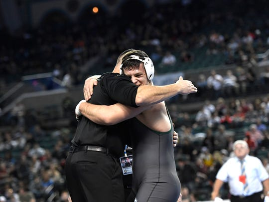 Montville's Liridon Leka hugs his coach after winning