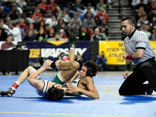 Delbarton's Anthony Clark nearly pins St. Joseph Regional's Samuel Alvarez during the 113-pound final bout of the NJSIAA state wrestling championships in Atlantic City, NJ on Sunday, March 4, 2018.