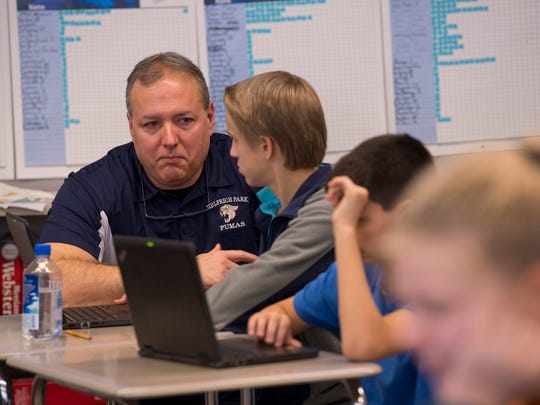 Dave Purvis, Language Arts teacher at Helfrich Park STEM Academy, works with his students one-on-one when needed.