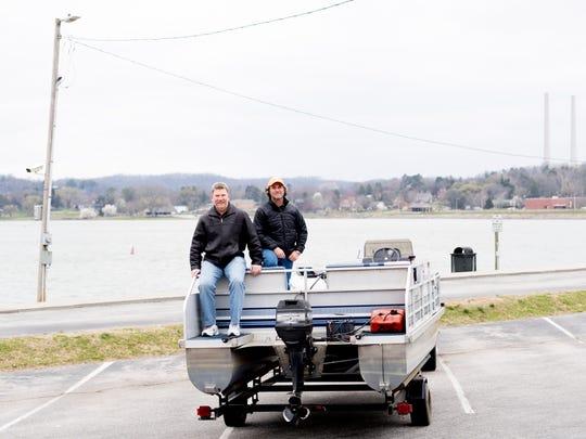 Brian Niekerk and Mack Schmidt sit atop their boat