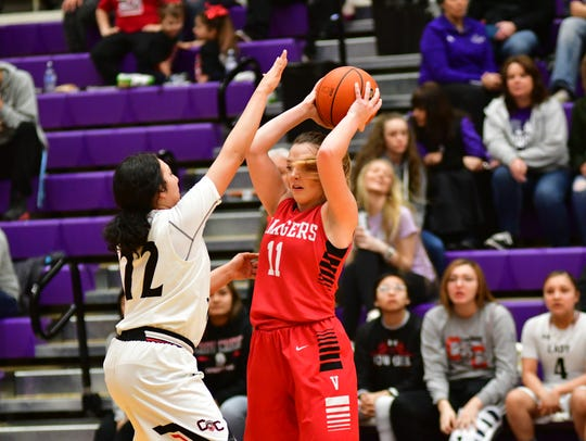 Vermillion's Haleigh Melstad looks to pass as Crow