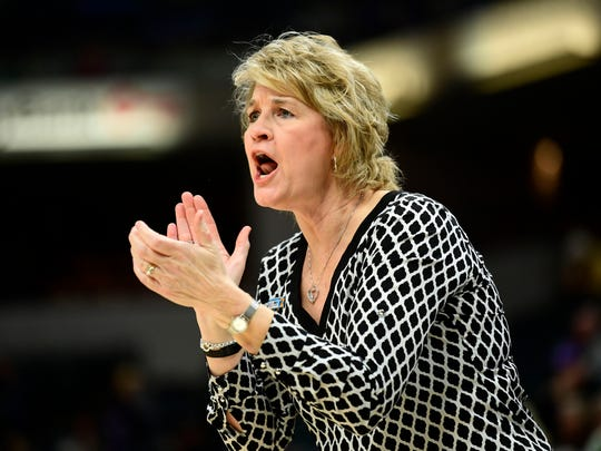 Iowa Hawkeyes head coach Lisa Bluder directs her team in the first half against the Northwestern Wildcats during the second round of the Big Ten Conference Tournament at Bankers Life Fieldhouse.