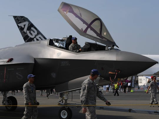 U.S. military personnel escort a Lockheed Martin F-35 fighter jet towards the runway at the International Paris Air Show on June 21, 2017.