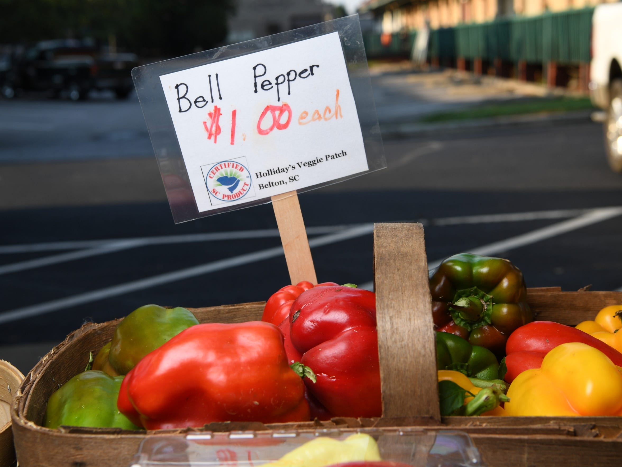 A display of bell peppers grown at Holliday's Veggie Patch in Belton, local farm-grown vegetables for sale during morning activity at the Anderson County Farmer's Market in Anderson in 2017.