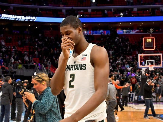 Jaren Jackson covers his face while leaving the floor Sunday after the loss to Syracuse.