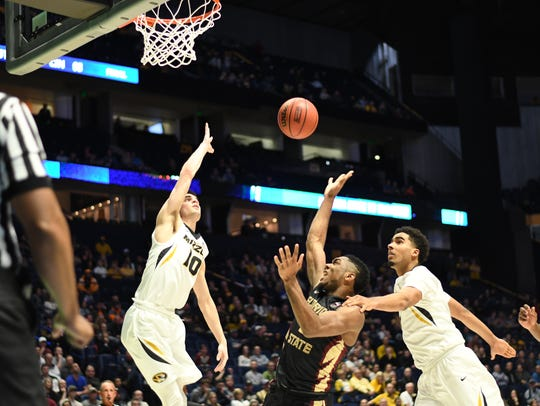 Sophomore guard Trent Forrest is fouled by Missouri