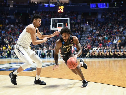 Senior forward Phil COfer drives around a defender to find the basket en route to the Seminoles' 75-70 victory over No. 1 Xavier in the second round of the NCAA Tournament.