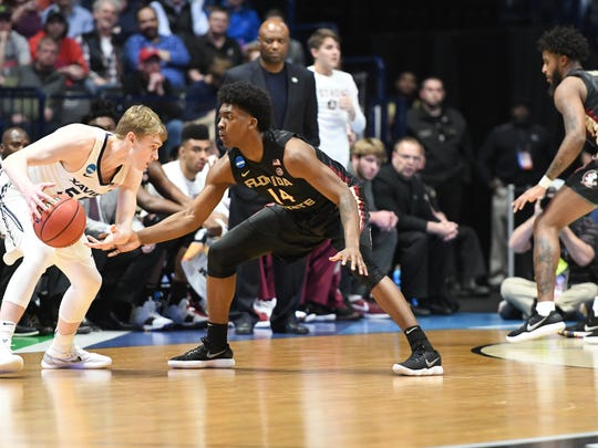Junior guard Terance Mann locks down an Xavier Musketeer en route to a 75-70 victory over the No. 1 seed in the second round of the NCAA Tournament.
