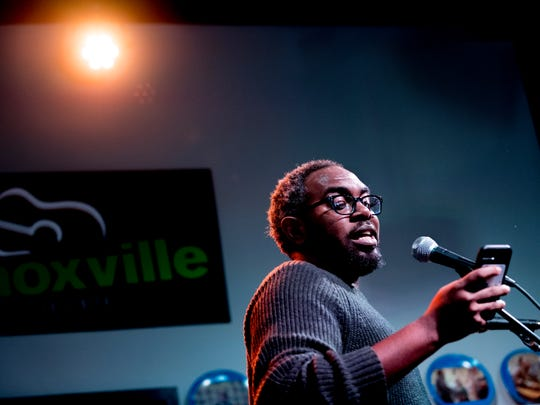 Knoxville poet Black Atticus reads a poem at the kickoff party for Big Ears 2018 at the Knoxville Visitors Center in Knoxville, Tennessee on Thursday, March 22, 2018.