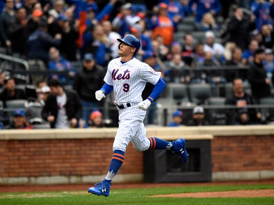 New York Mets center fielder Brandon Nimmo (9) scores in the first inning. New York Mets face the St. Louis Cardinals on Opening Day at Citi Field in Flushing, NY on Thursday, March 29, 2018.
