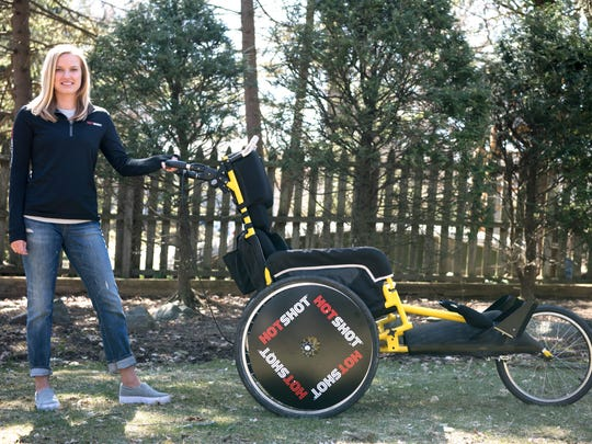 Kaitlyn Kiely will be running the Boston Marathon route while pushing her boyfriend Matt Wetherbee in a racing wheelchair. Kiely with her boyfriend's racing wheelchair on Saturday, March 31, 2018.