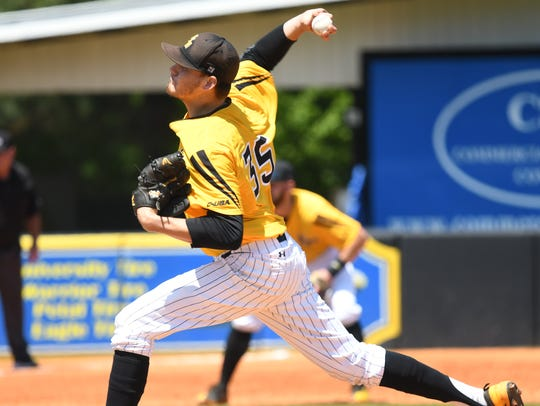 Southern Miss starting pitcher Walker Powell delivers