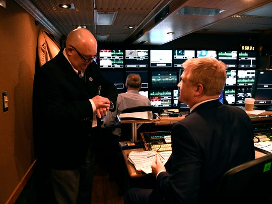 Off-ice official Peter Lanigan checks in with producers in the local TV truck before the Devils' last regular-season home game at the Prudential Center on Thursday, April 5, 2018.