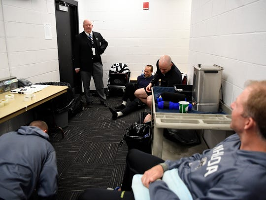 Off-ice official Peter Lanigan meets with the referees before the Devils' last regular-season home game at the Prudential Center on Thursday, April 5, 2018.