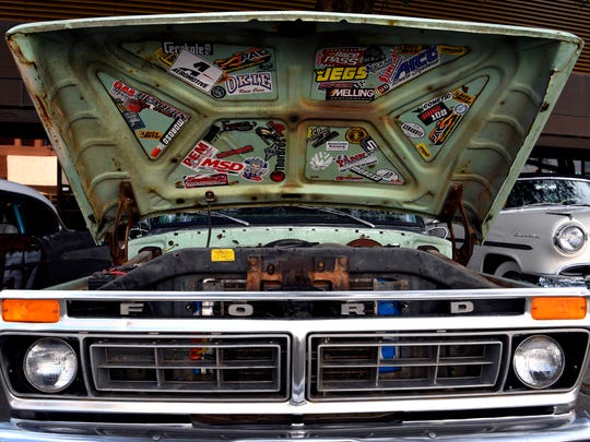Stickers adorn the underside of the hood of a vintage Ford pickup during Thursday's CarWalk.