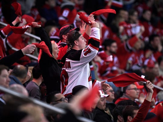 New Jersey Devils fans cheer as they face the Tampa Bay Lightning in Game 3 of Round 1 of the Stanley Cup Playoffs at the Prudential Center in Newark, NJ on Monday, April 16, 2018.