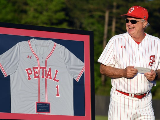 Longtime Petal baseball coach Larry Watkins smiles prior to Friday's home playoff game during a ceremony retiring his jersey. Watkins announced this season was his last with the Panthers after 38 seasons as head coach.
