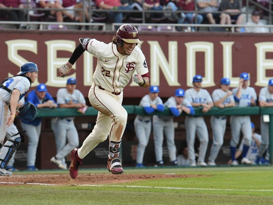 FSU's Drew Mendoza sprinting to first base during the fifth inning in FSU's matchup against tweltfh ranked Duke.